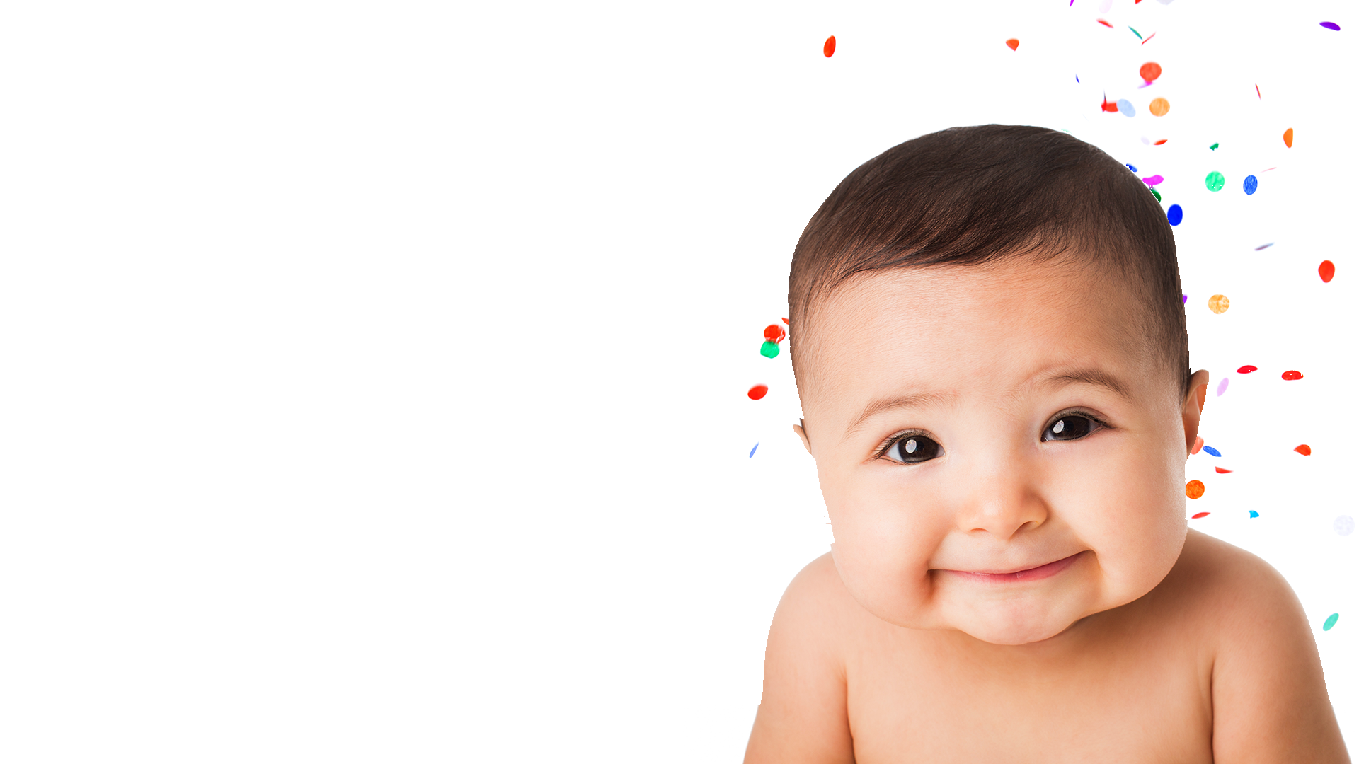 smiling baby with confetti