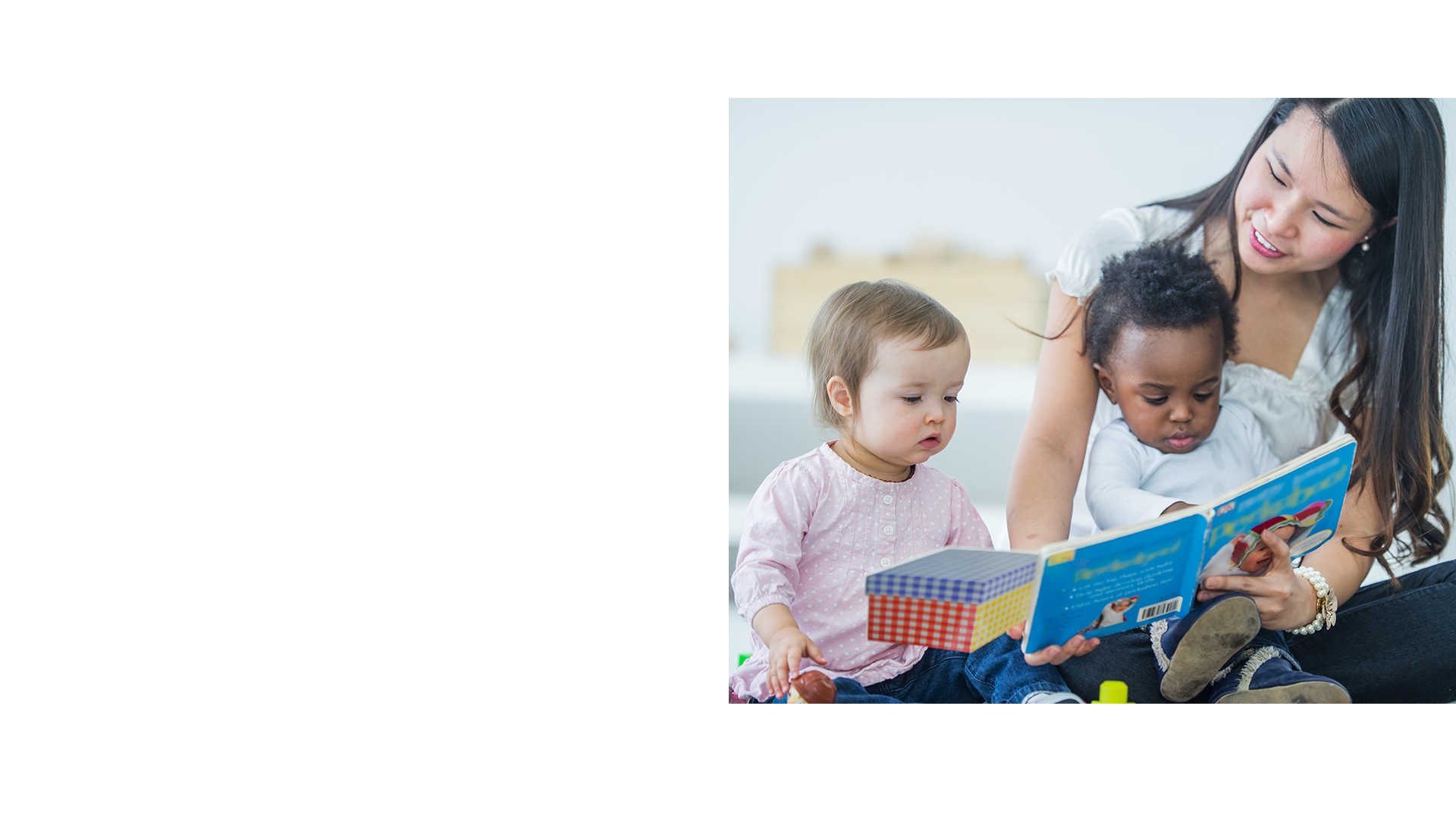 woman with children reading
